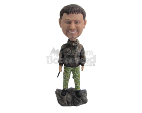 Custom Bobblehead Hunter Wearing A Camouflage Jacket Standing Over Rock - Sports & Hobbies Fishing Personalized Bobblehead & Cake Topper