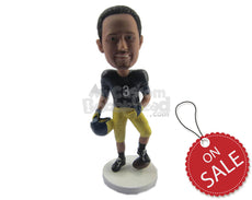 Custom Bobblehead Strong Football Player Giving A Pose With The Ball Under His Feet In Helmet In Hand - Sports & Hobbies Football Personalized Bobblehead & Cake Topper
