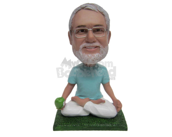 Custom Bobblehead Male Yoga Fan In Relaxing Pose And With Apple In Hand - Sports & Hobbies Yoga & Relaxation Personalized Bobblehead & Cake Topper