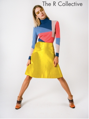 girl with yellow skirt and blocks of colour top