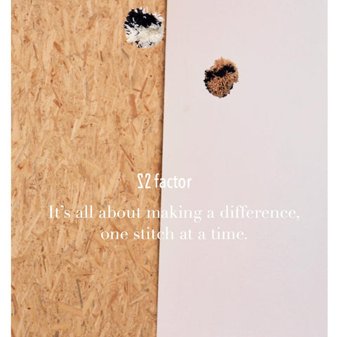 an image with a quote saying 'making a difference one stitch at a time' with 22 factor's logo on it