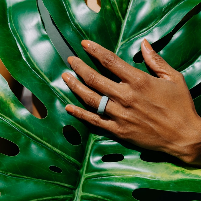 Beautiful dark complexion woman's hand sporting the new Enso Ring's Coral Apo Reef design