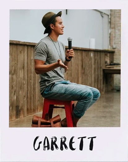 Garrett Gee Close sitting on a stool with a microphone