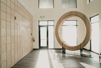 A giant wooden ring made by Nine O from hundreds of wooden slabs