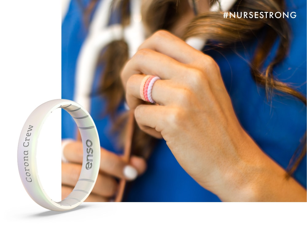 Close up image of a nurse's hand wearing 3 Enso Braided Stackable rings