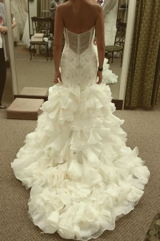 71113cfde22 curve-hugging-beaded-wedding-dresses-with-ruffled-textured-