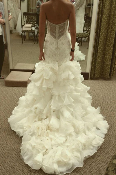 curve-hugging-beaded-wedding-dresses-with-ruffled-textured-skirt-1