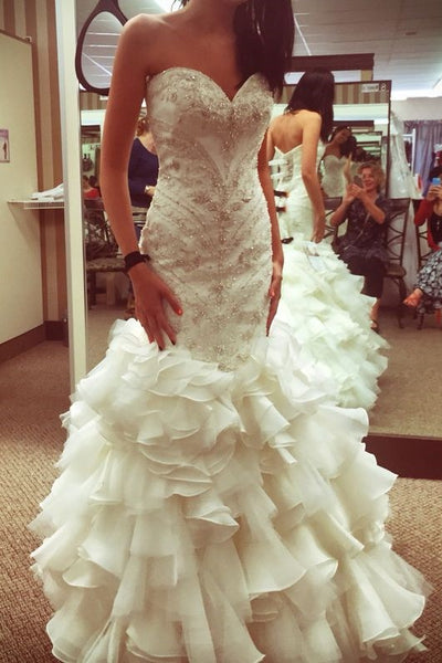 curve-hugging-beaded-wedding-dresses-with-ruffled-textured-skirt