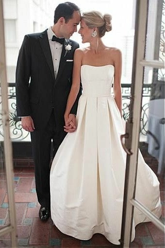 curve-strapless-satin-wedding-gown-with-box-pleats