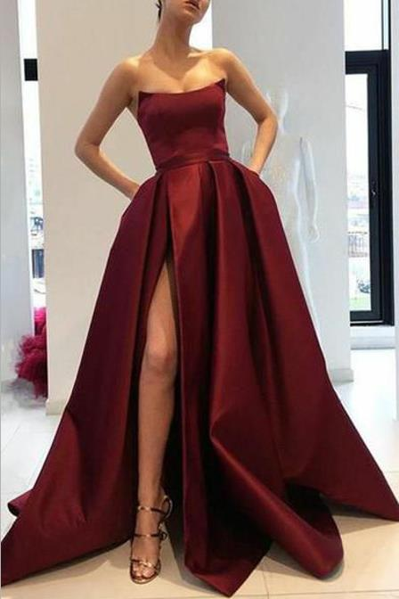 curved-strapless-burgundy-prom-gowns-slit-side