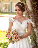 ivory-tulle-wedding-gown-with-ruffles-illusion-neckline-2