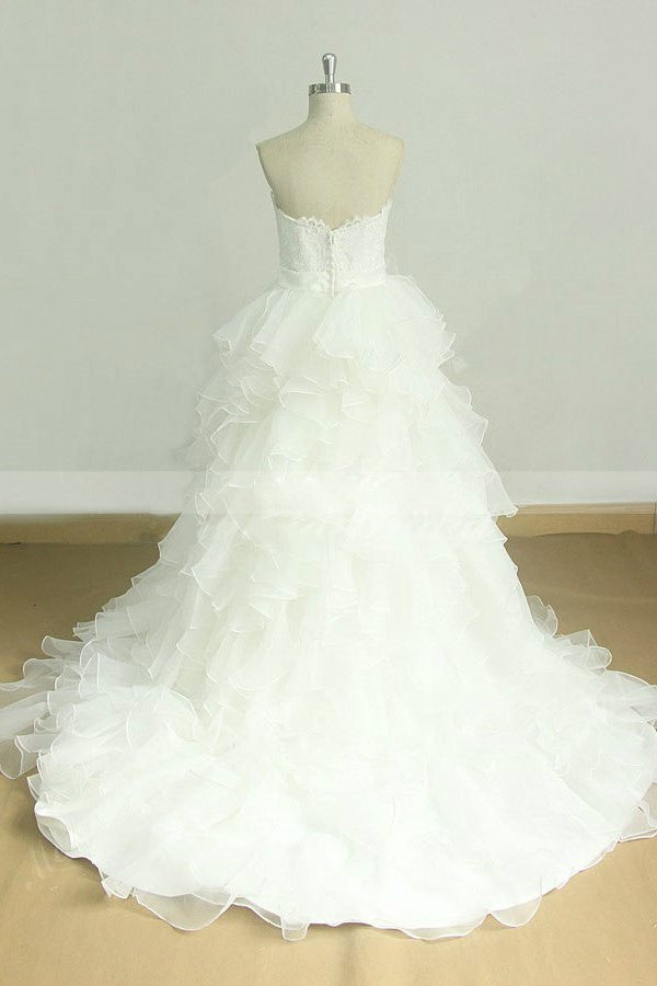 lace-strapless-wedding-gown-with-ruffled-organza-skirt-1
