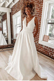 plunging-v-neck-satin-bridal-gown-with-pockets