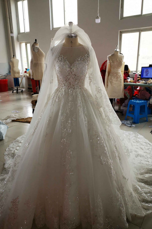 romantic-lace-long-sleeves-wedding-gown-with-sheer-neckline