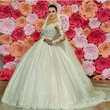 sheer-lace-long-sleeves-wedding-dress-with-appliqued-train-2