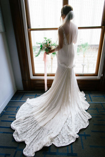 sheer-lace-mermaid-wedding-dress-with-v-back