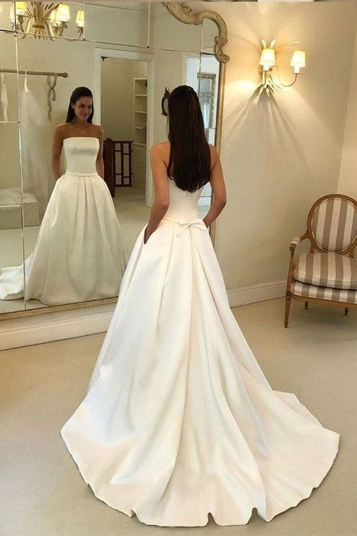 strapless-open-back-satin-wedding-gown-with-pockets-1