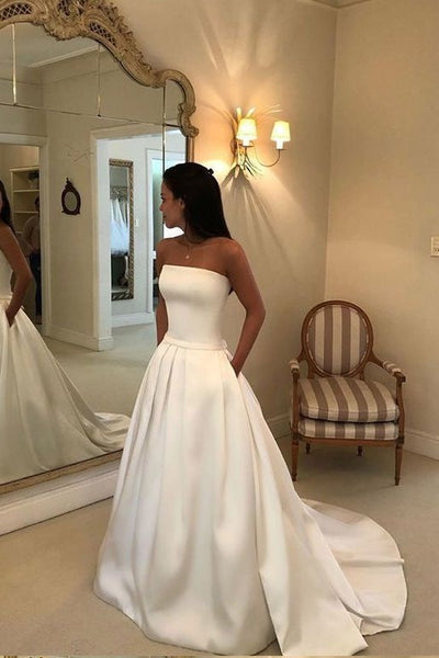 strapless-open-back-satin-wedding-gown-with-pockets