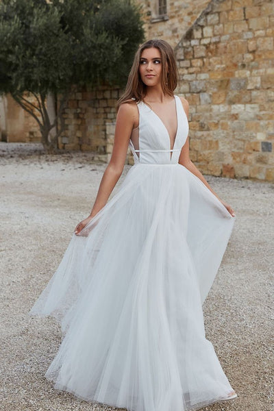 transparent-plunging-white-tulle-wedding-dress-beach-1
