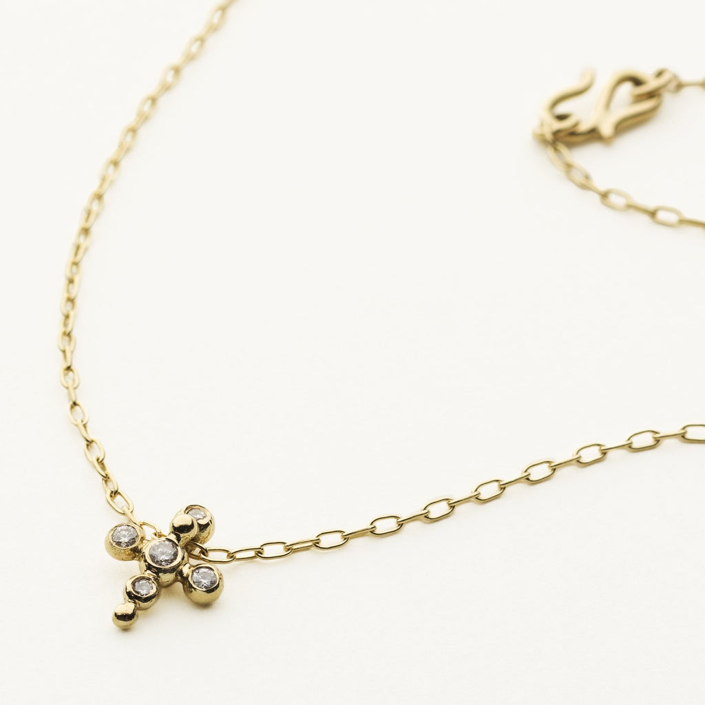 ASYMMETRIC CROSS NECKLACE - 18 karat gold with diamonds