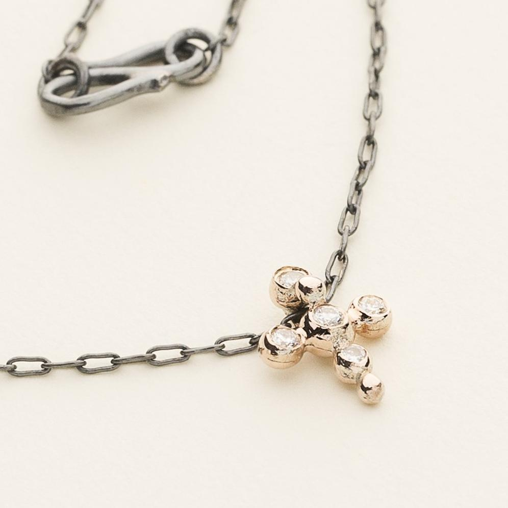 ASYMMETRIC CROSS NECKLACE - silver and 9 karat rose gold with diamonds