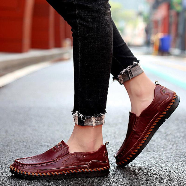 Male hand stitches big yards casual shoes