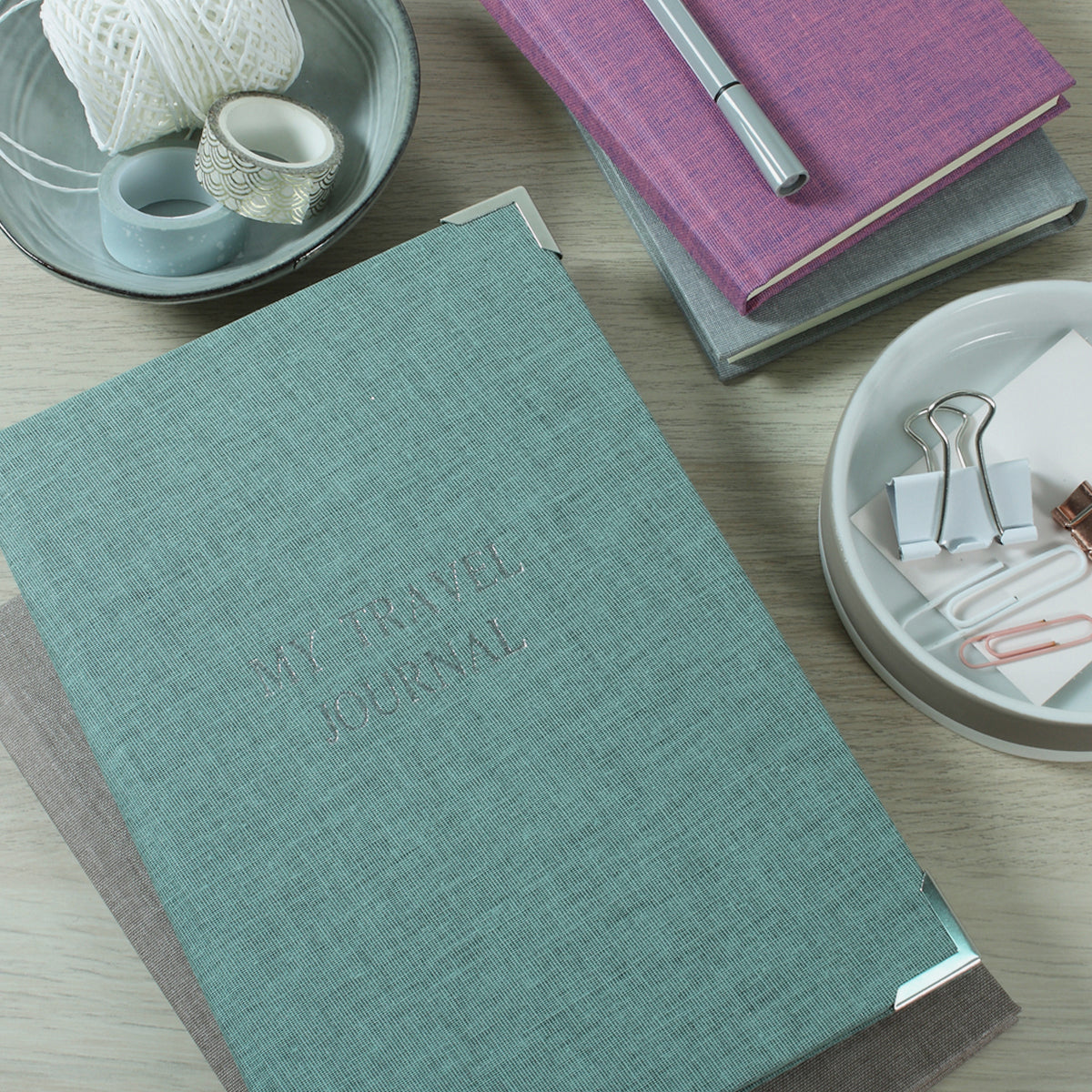 A Harris & Jones fabric journal with corner protectors.