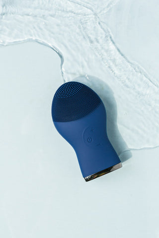 Blue face cleansing brush