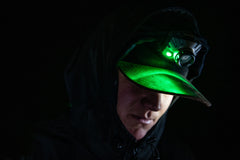 Man in Hat Uses Green LED from Headlamp At Night, lifestyle photo