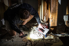 Man using LED Flashlight to Look at Electrical Wiring, lifestyle photo