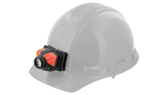 A hard hat with an LED headlamp attached by the COAST adhesive helmet mount.