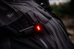 Red Light Clipped Onto Black Jacket, lifestyle photo