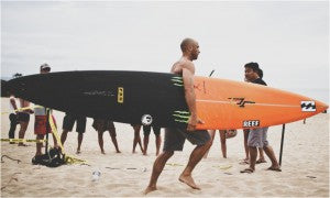 shane-dorain-with-gun-big-wave-surfing