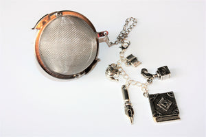 Author and Poet inspired tea infuser with charms
