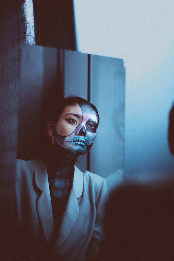 reflection-of-woman-with-face-paint