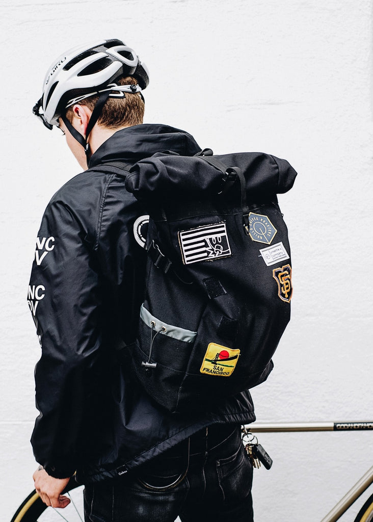patched-up-rolltop-backpack-commuter-unsettle