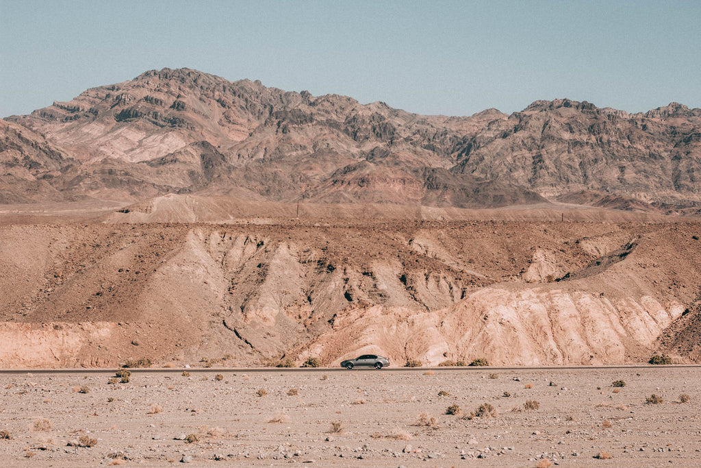 car-driving-on-empty-road-in-desert
