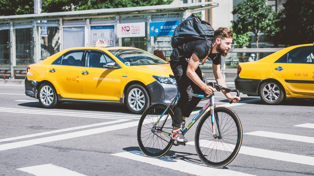 fixed-gear-rider-biking-through-city-traffic