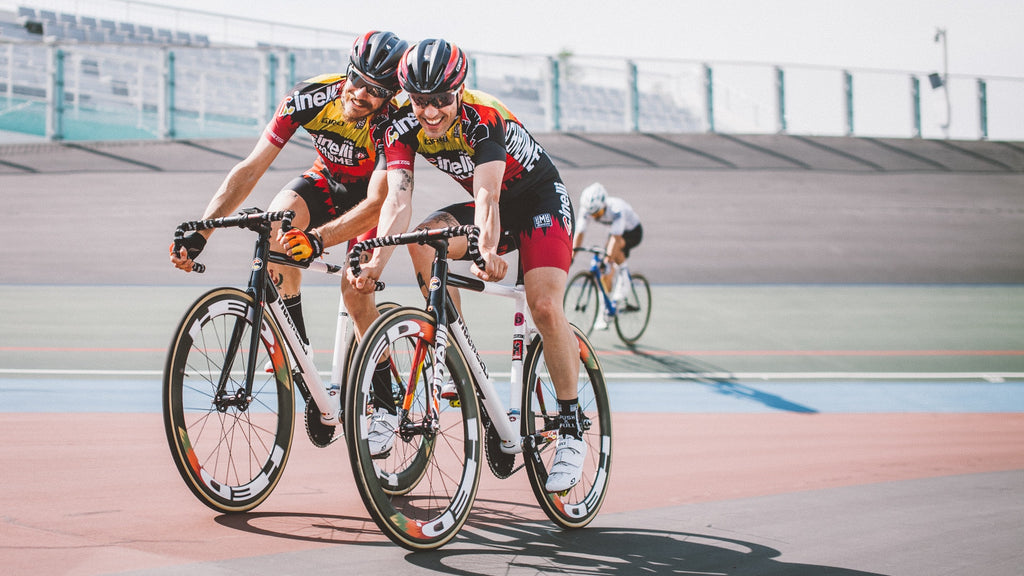 happy-cyclists-on-velodrome-track