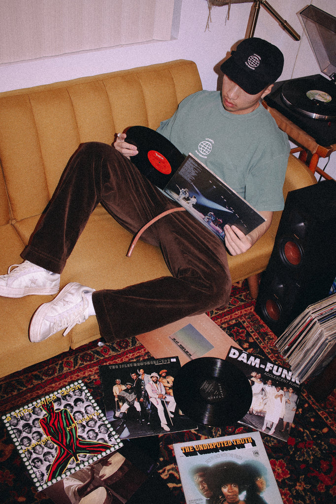 man reading vinyl record listening to records on couch