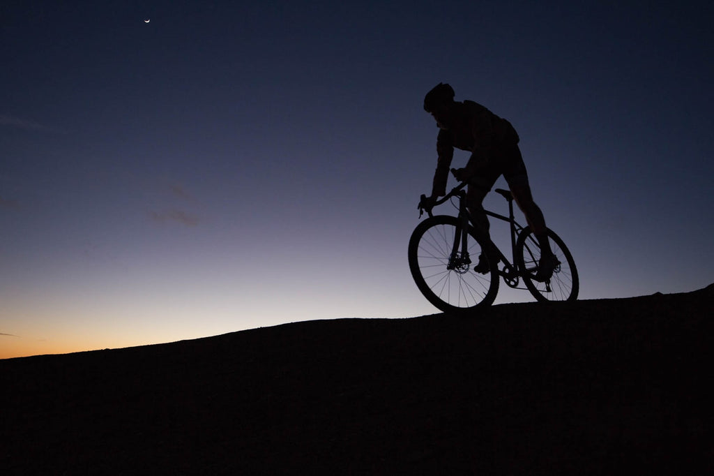 mountain-biker-riding-at-night
