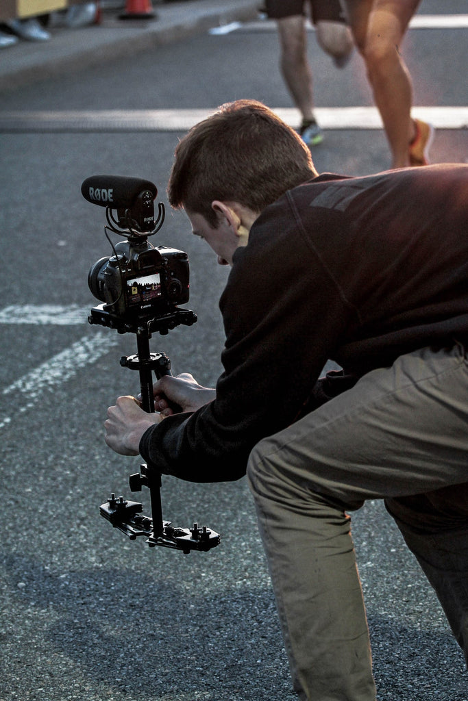 camera-man-using-stablizer-for-filming