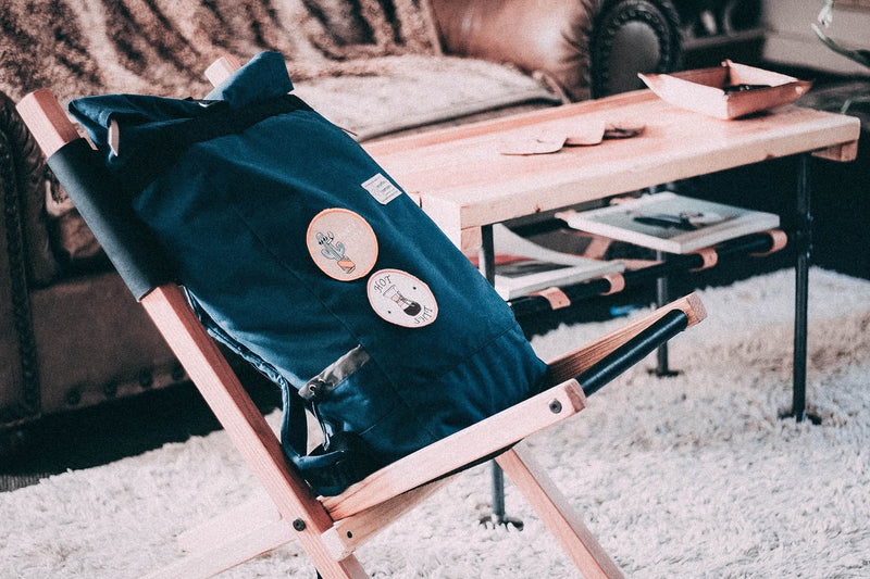 roll-top-backpack-on-chair-interior-design