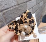 Leopard bow brooch