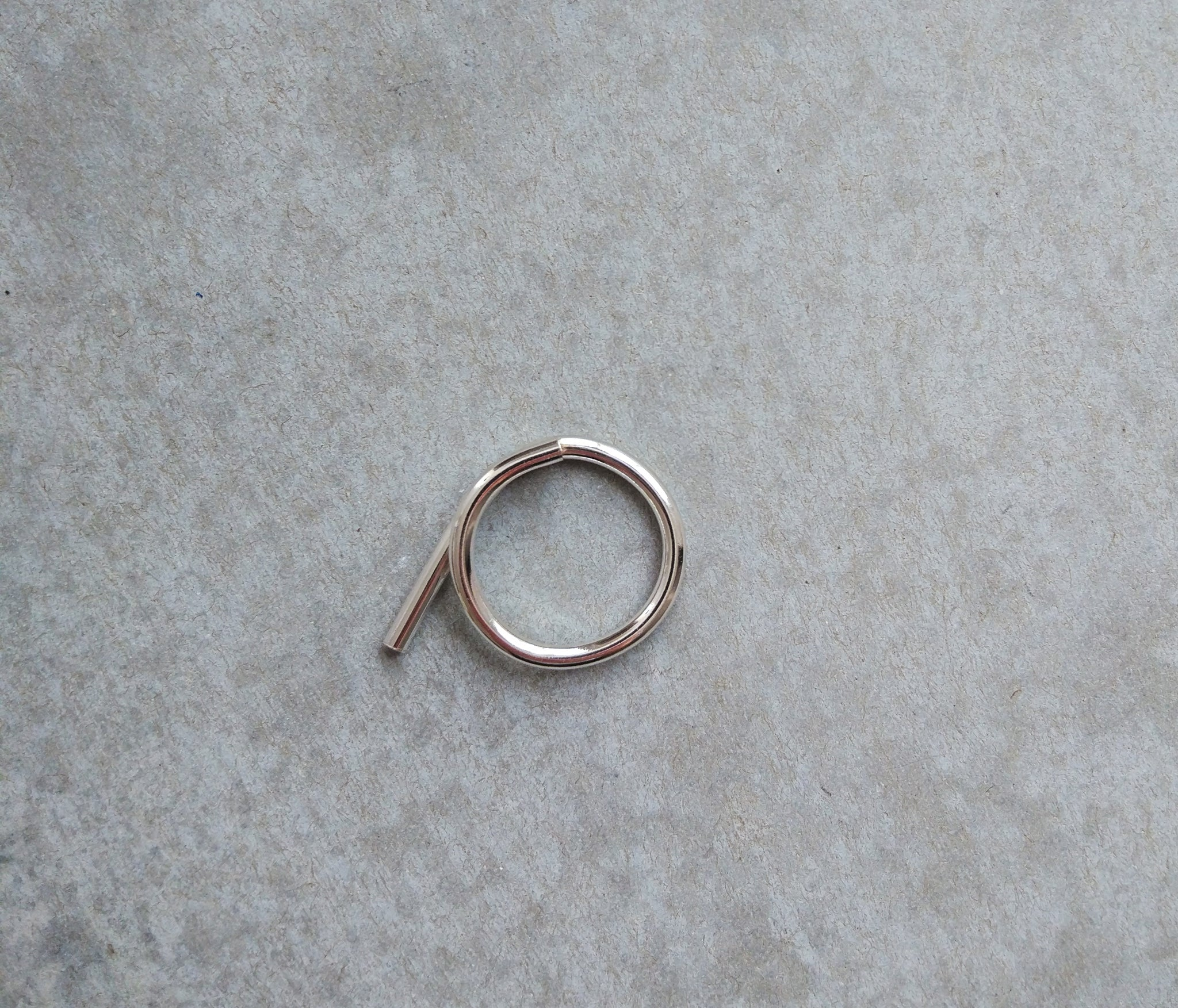 TWISTED ASYMMETRICAL SILVER RING