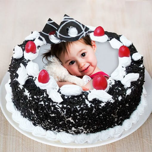 round-shape-black-forest-cake-with-a-baby-photo-on-top
