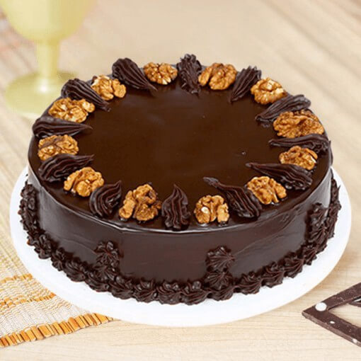 round-shape-with-walnut-ontop-chocolate-cake