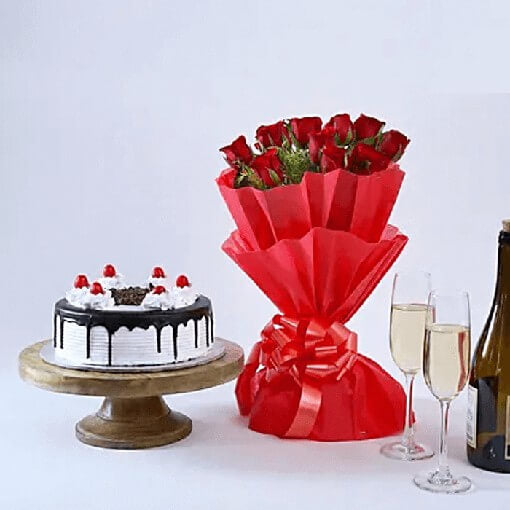 Black-forest-round-cake-with-bouquet-of red-roses