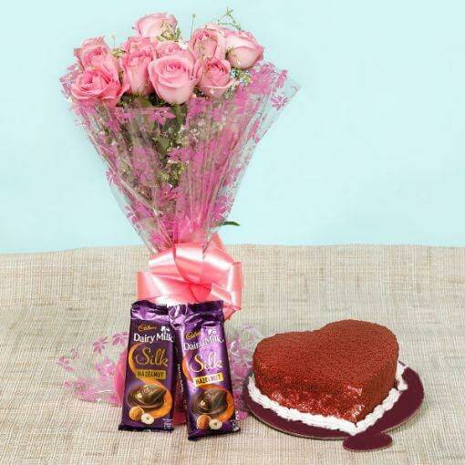 red-velvet-heart-shape-cake-Cadbury-chocolates-with-pink-color-roses-bouquet