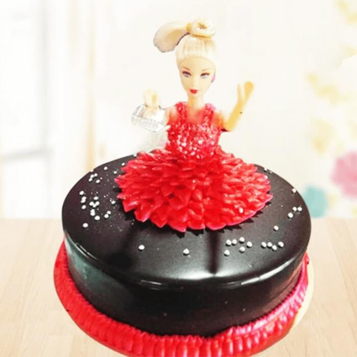 round-shape-chocolate-cake-with-red-barbie-cake-in-middle